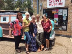 RKC 50th Committee girls acting up in front of Texas Surf Museum -- Sherrie, Debbie, Melissa, Lindy, Debra